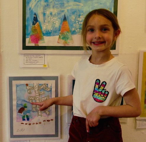 2021 Young Artist Showcase student near art